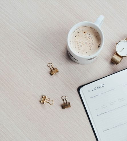 Open planner on wooden table