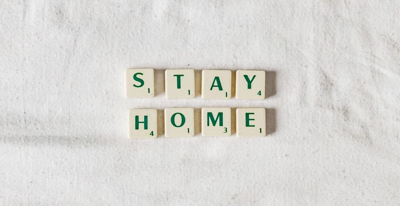 scrabble letters reading the words: stay home