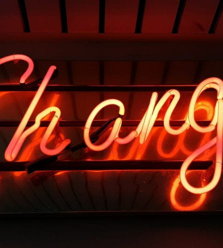 A neon sign that reads Change