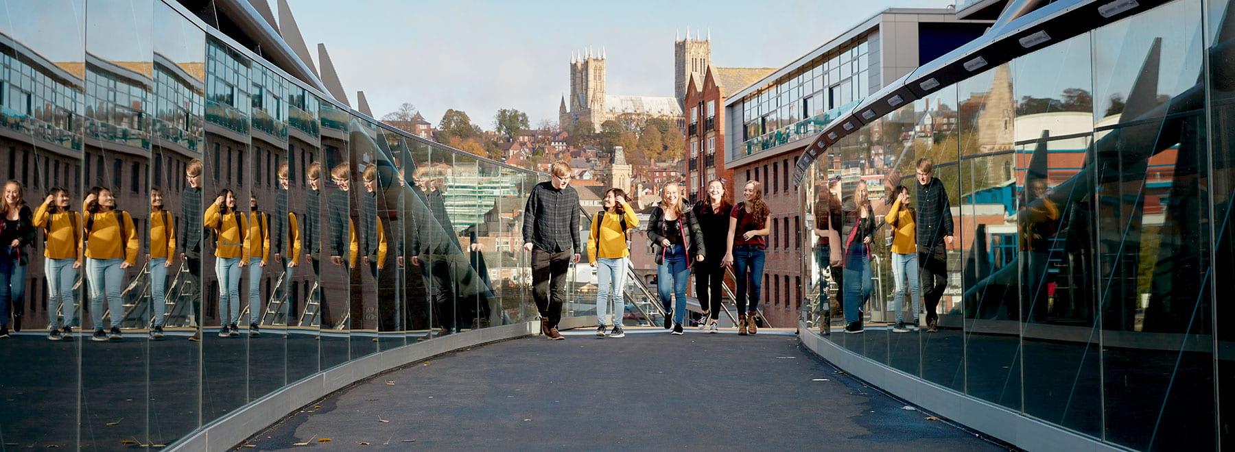 students walking across walkway.