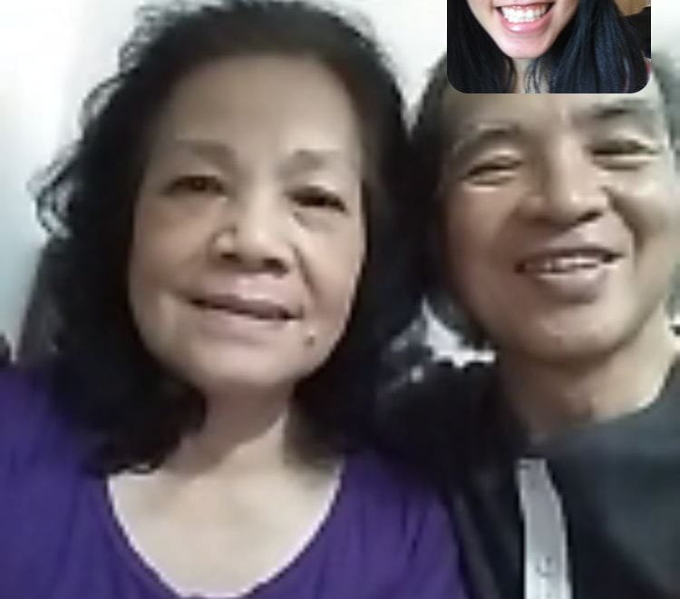 Student on a video call with her parents