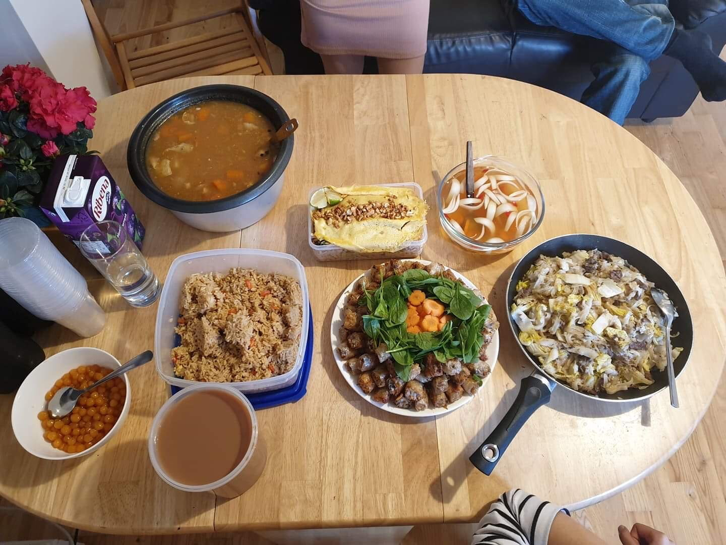 Table filled with international homemade dishes