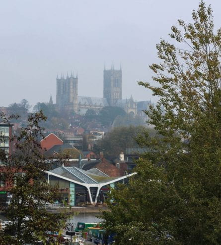 Photograph overlooking the Brayford river with the cathedral visible in the background