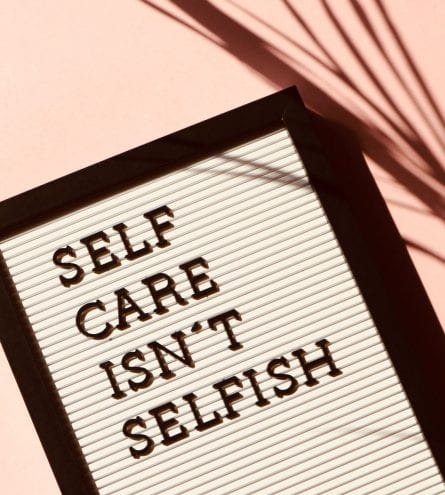 A board that reads 'self care isn't selfish'