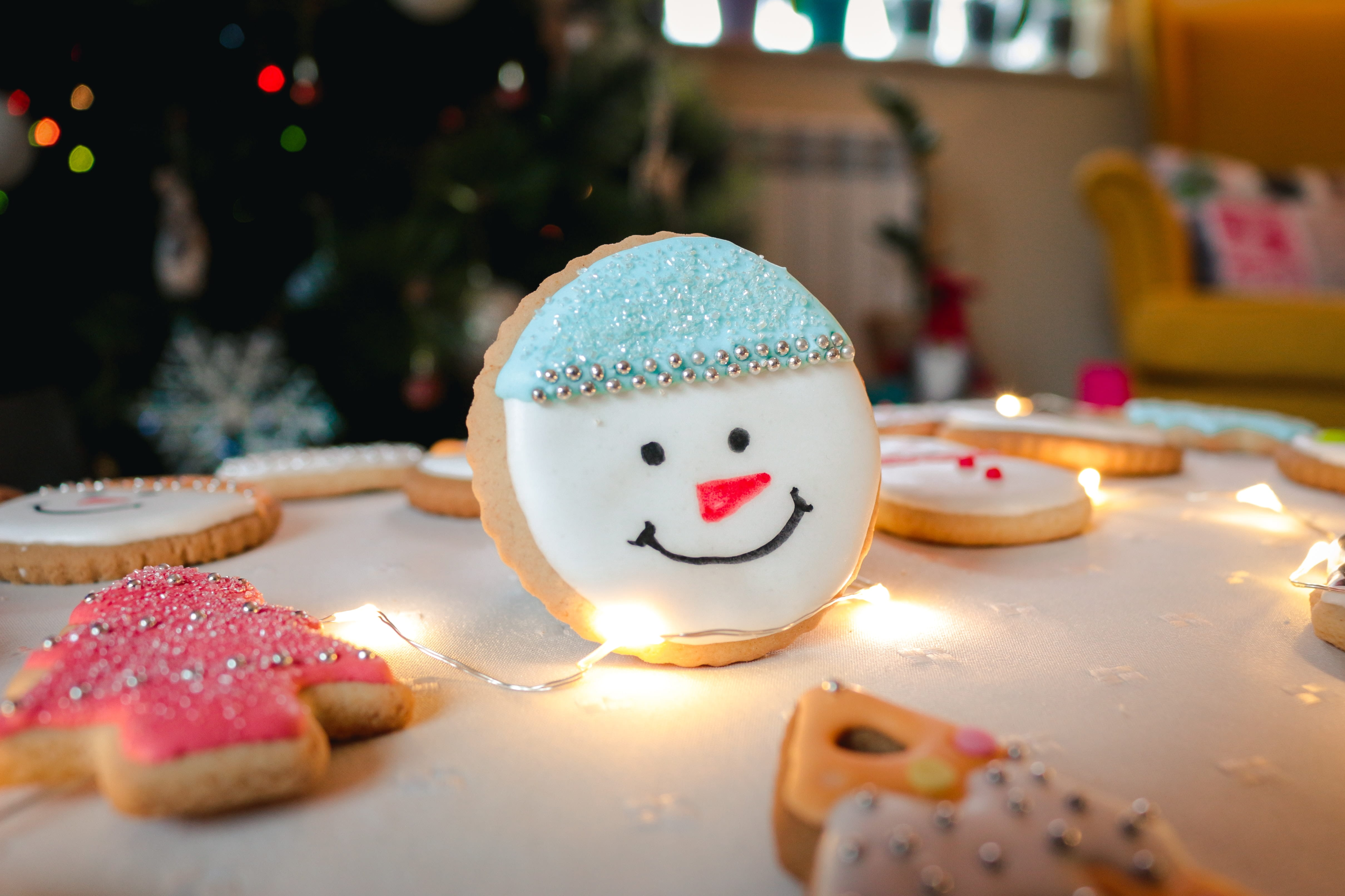 a christmas cookie with the face of a snowman
