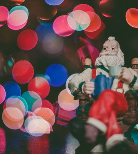 Close up of a santa figure with blurred lights surrounding