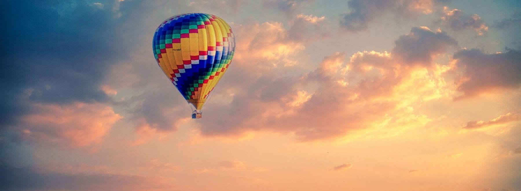 Hot air balloon in the air during sunrise