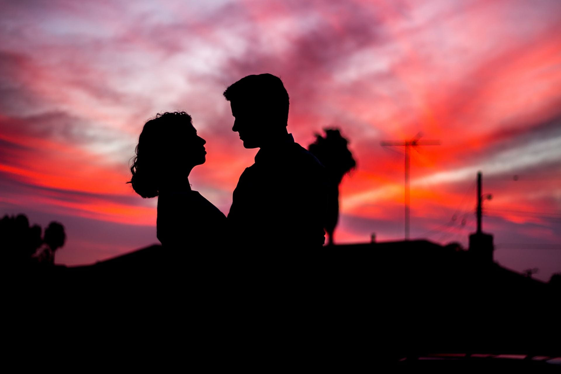 silhouette of a couple in front of sunset