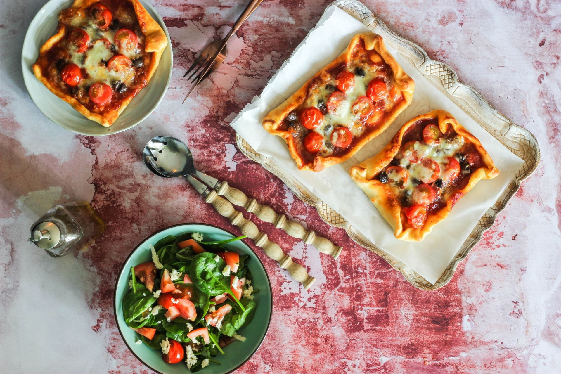 Home made pizza slices with a salad