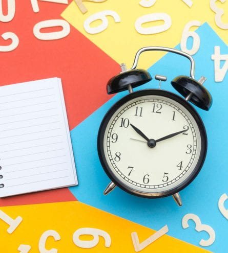A clock and notepad