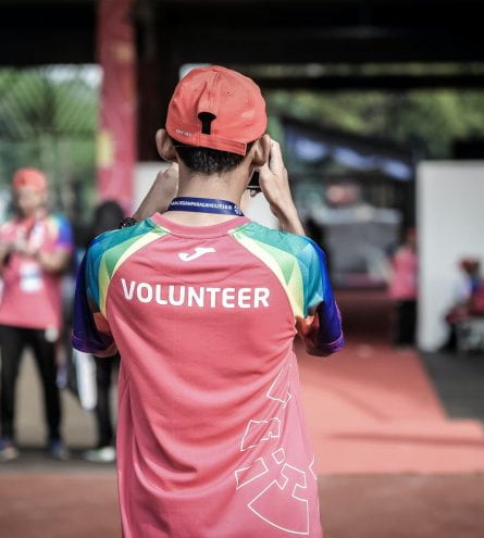 Someone with a volunteering shirt on abroad