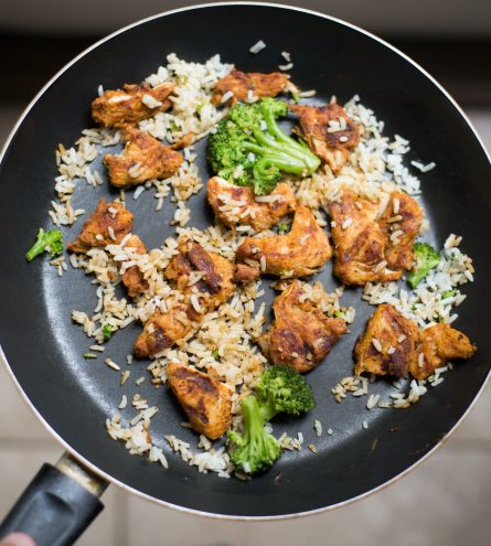 Chicken, rice and broccoli in a frying pan