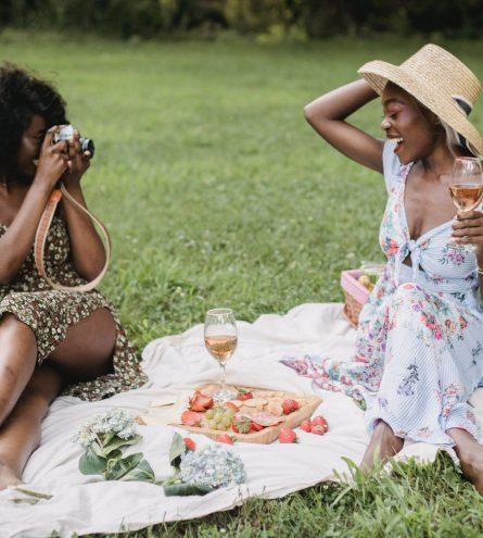 Two women sat having a picnic