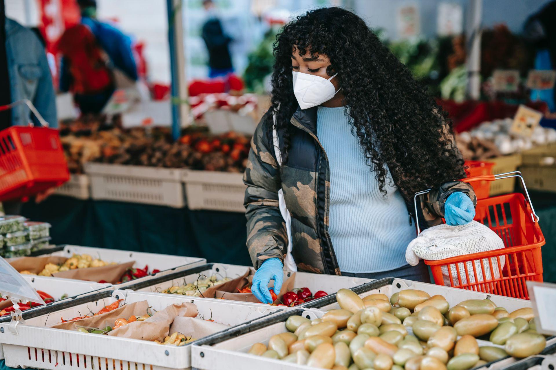 Woman wearing a mask at a market