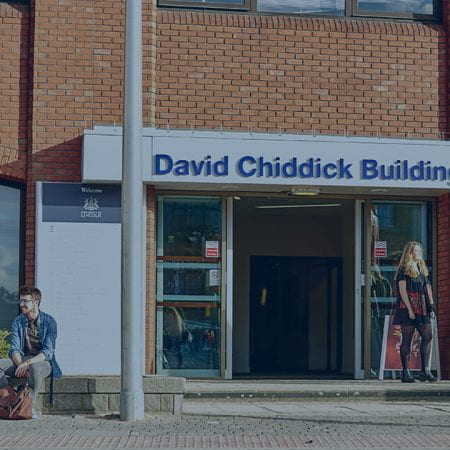 David Chiddick Building with students infront