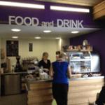 Inside Enterprise building cafe with 'Food and Drink' sign.