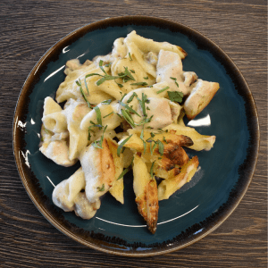 chicken pasta bake on a blue plate