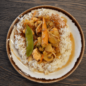 vegetables in an orange sauce on white rice