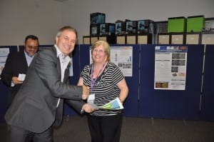 "Head of School handing in the ""Thank You"" Certificates for Helpers and the Admin Team."