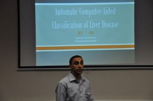 Hussein Presenting his work.