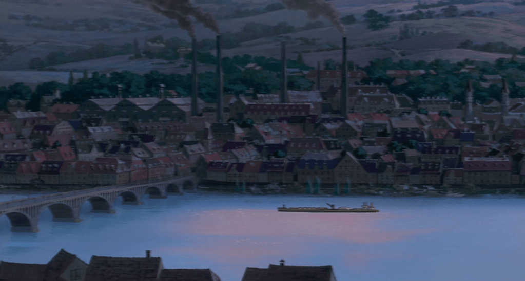 The town where Sophie lives. Darkness is complete and not a single light is visible, a situation which points plausibly to a wartime black out. The place, although unnamed, has a strong Central European flavour.