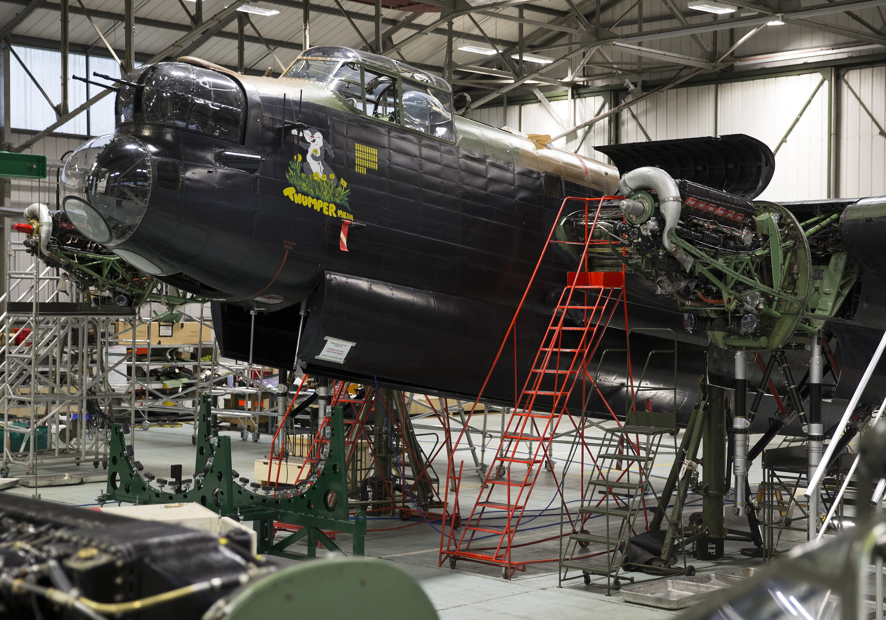 'Thumper', the Avro Lancaster Mk III undergoing maintenance in the BBMF hangar at RAF Coningsby.