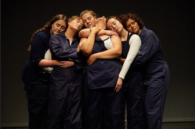 Six performers embracing