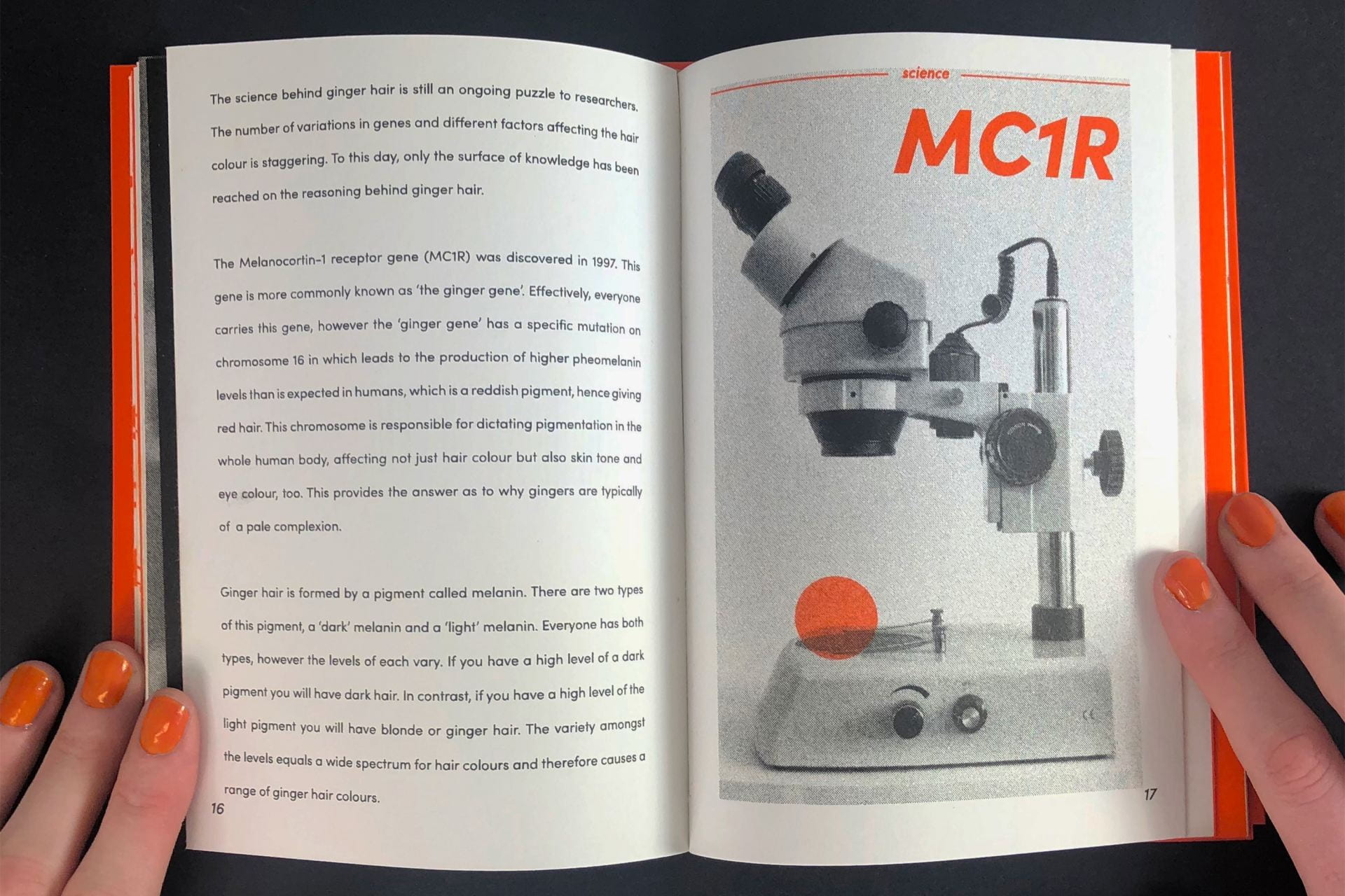 An open book with a picture of a microscope.