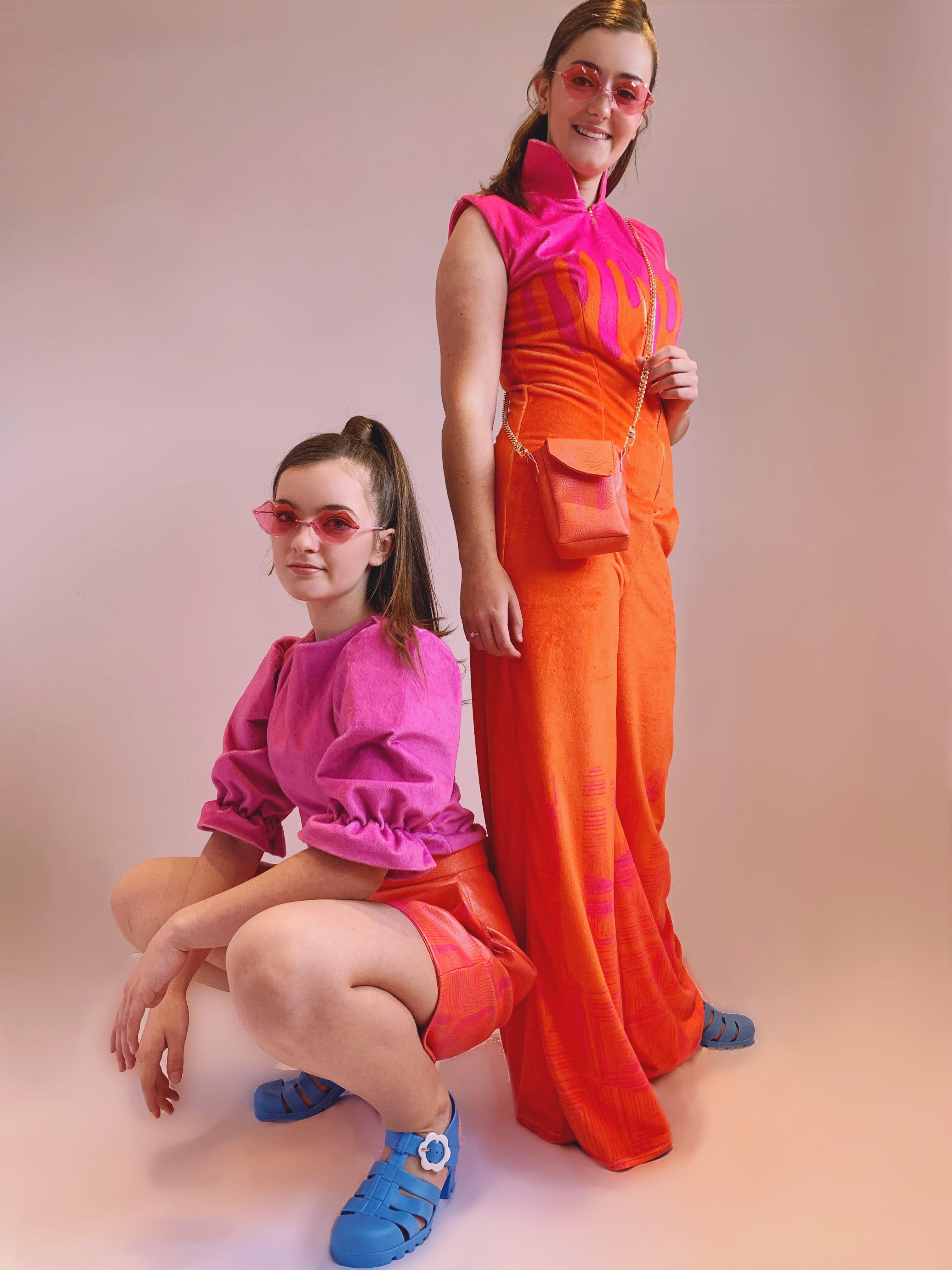 Photograph of two girls (one standing, one crouching) modelling an item in the 'Let's Get Trippy' collection.