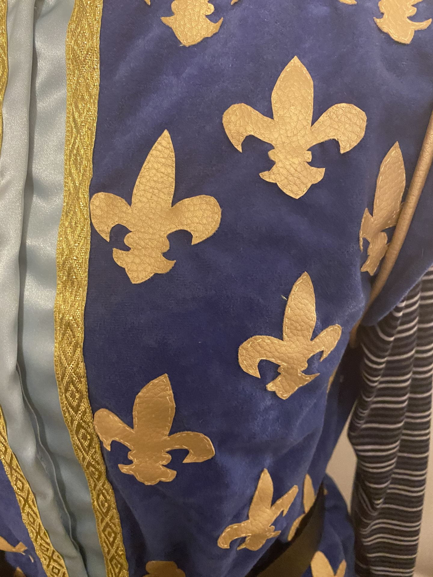 Close up for the blue and gold bodice details. Shoes the gold details and the stitching.