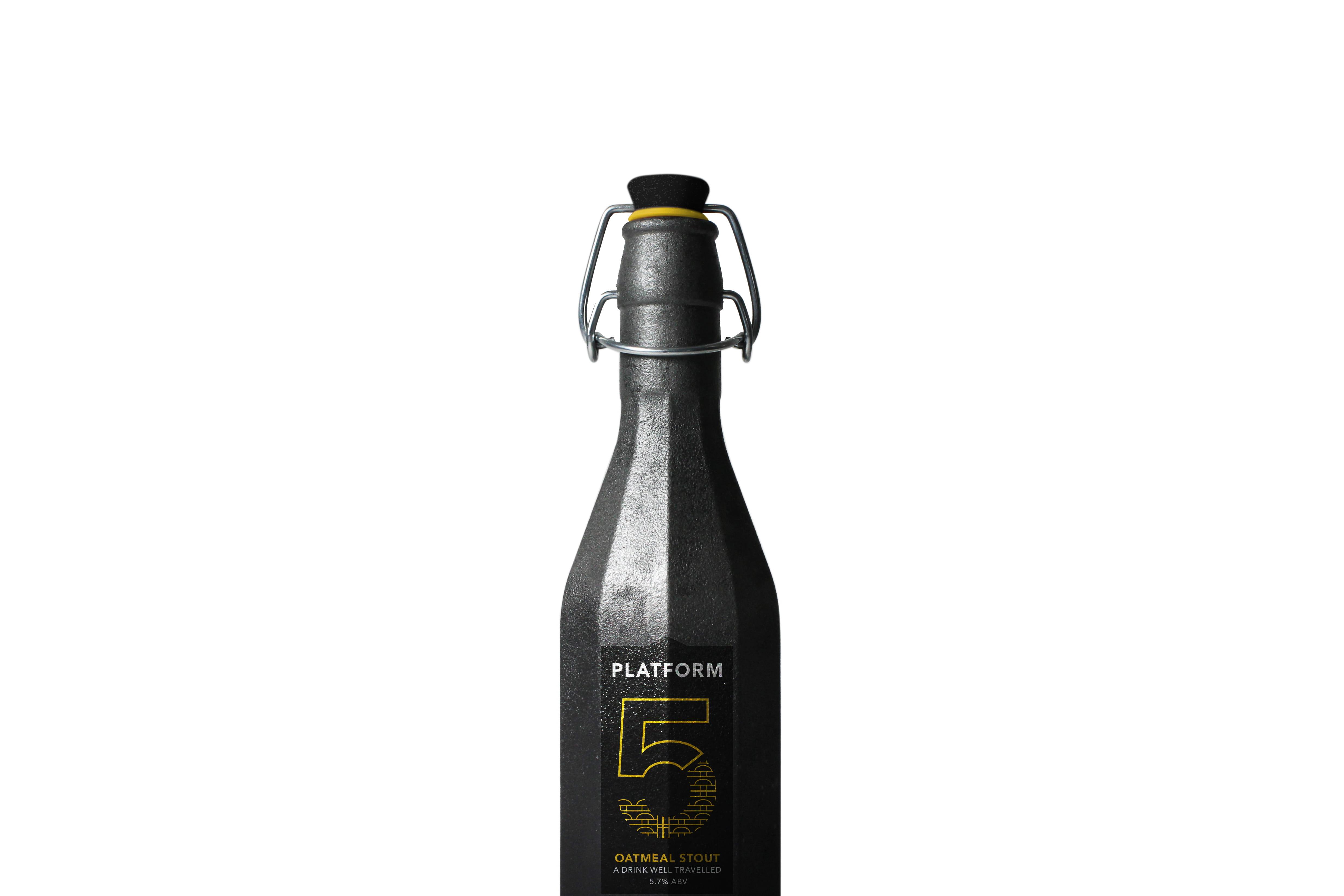 A dark pewter bottle with a black label, reading: 'Platform 5'.
