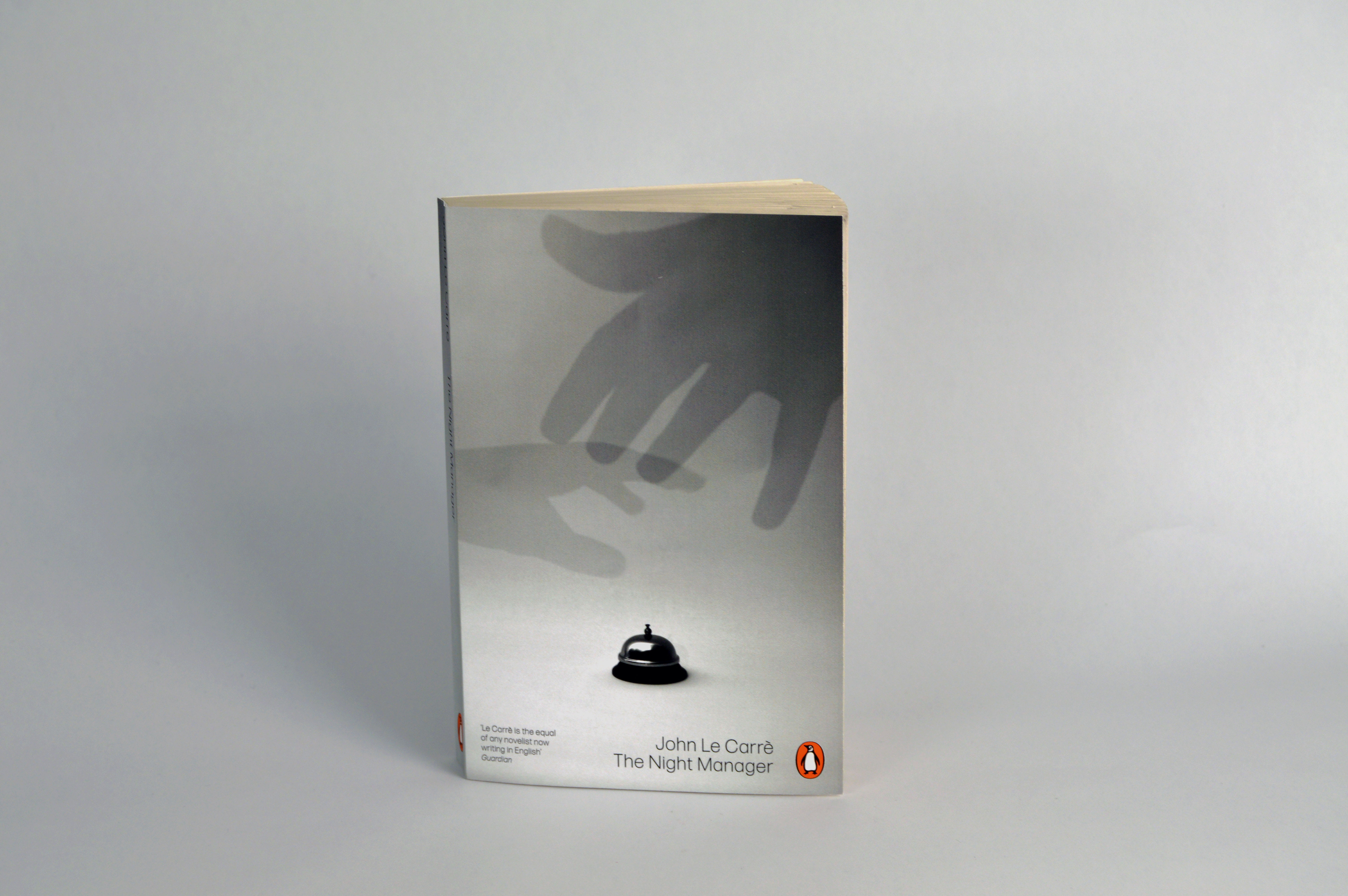 Front view of cover design depicting the artwork of 2 hands reaching for the receptionists bell.