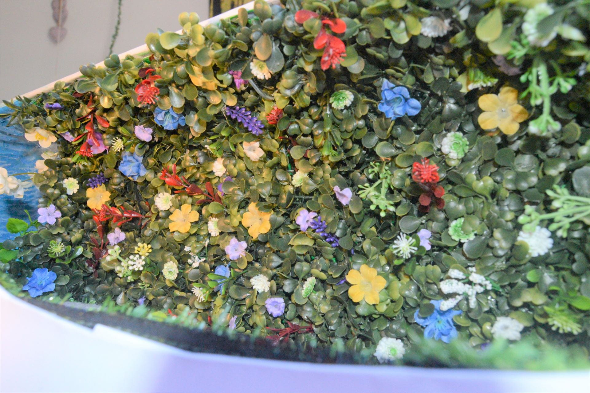 The Living walls vivid greens and bright colours from the flowers in summer bring the nature inside.