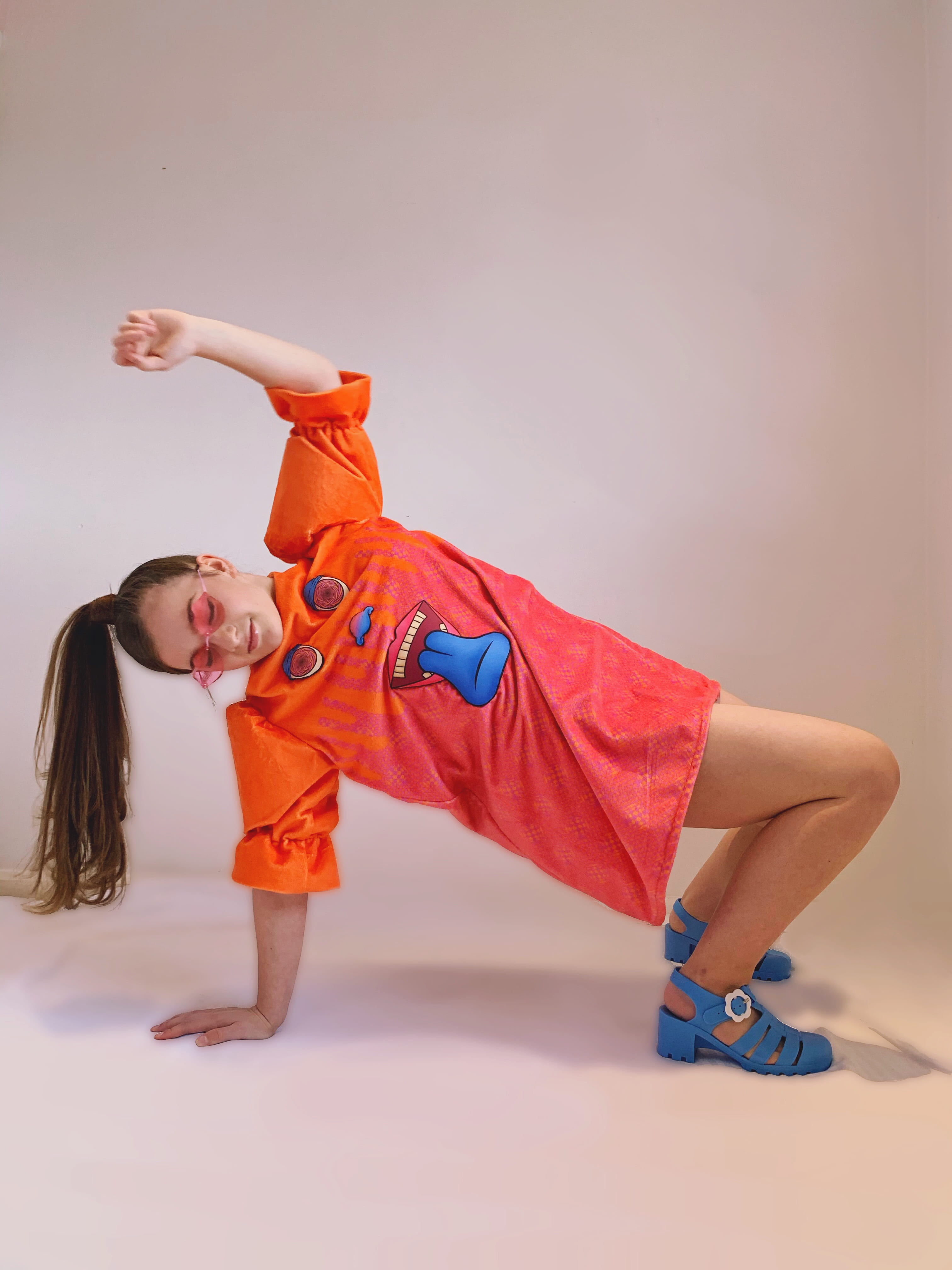 Photograph of a girl posing on the floor in an item in the 'Let's Get Trippy' collection.