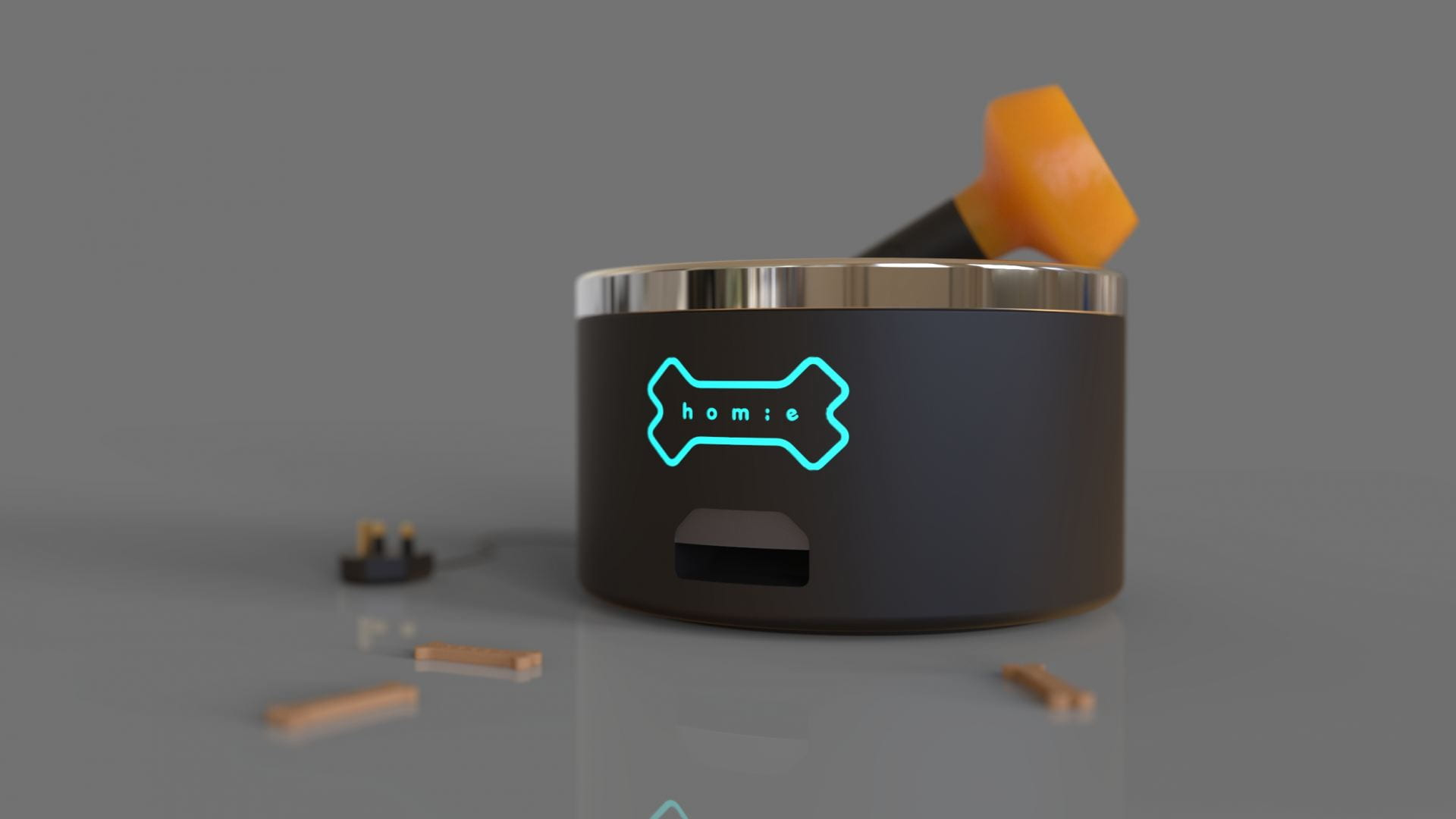 A dog bowl surrounded by some toys - Homie is a smart system that combats dog loneliness.
