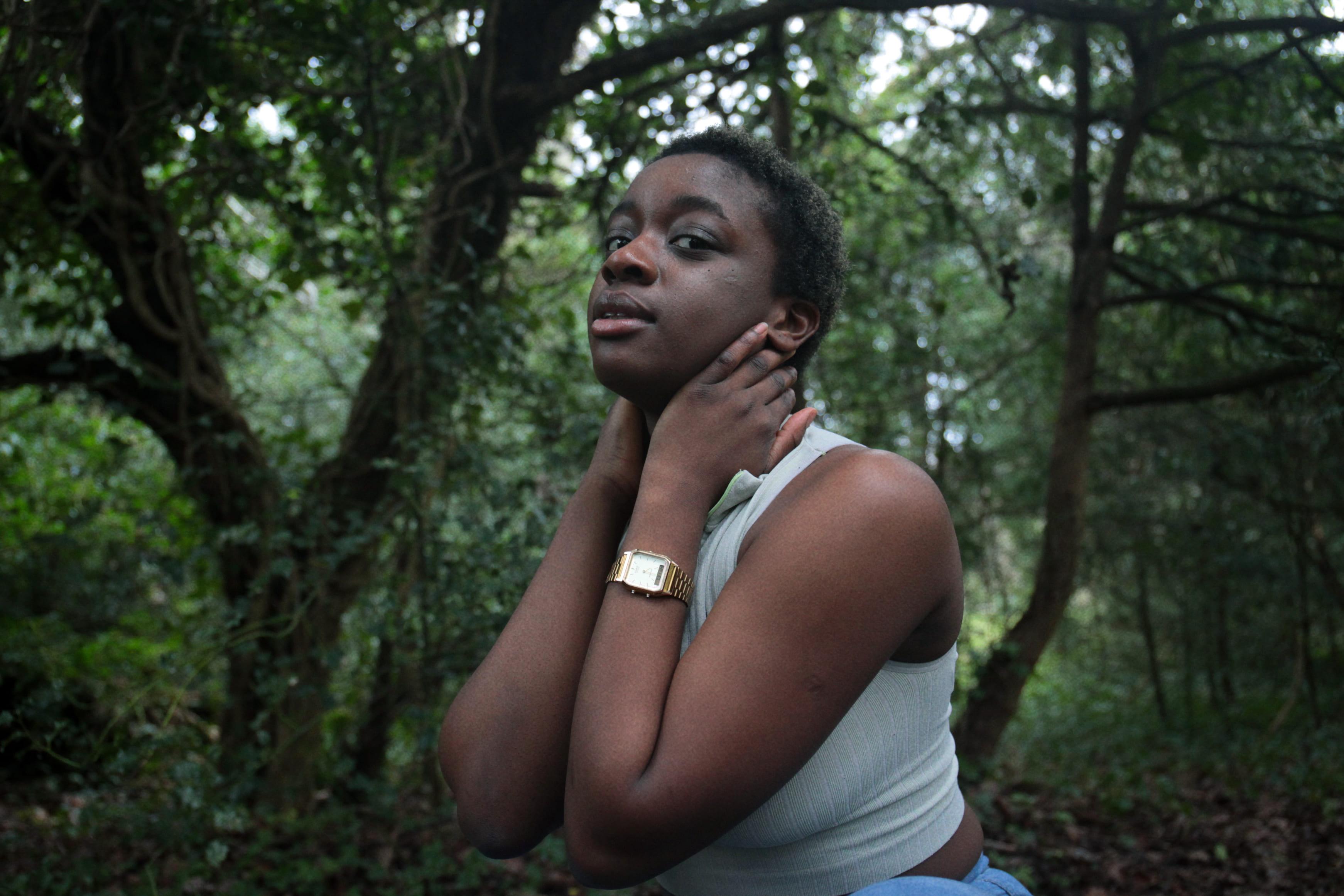 Image of black female, green leaves, Olivia Springate-Jones