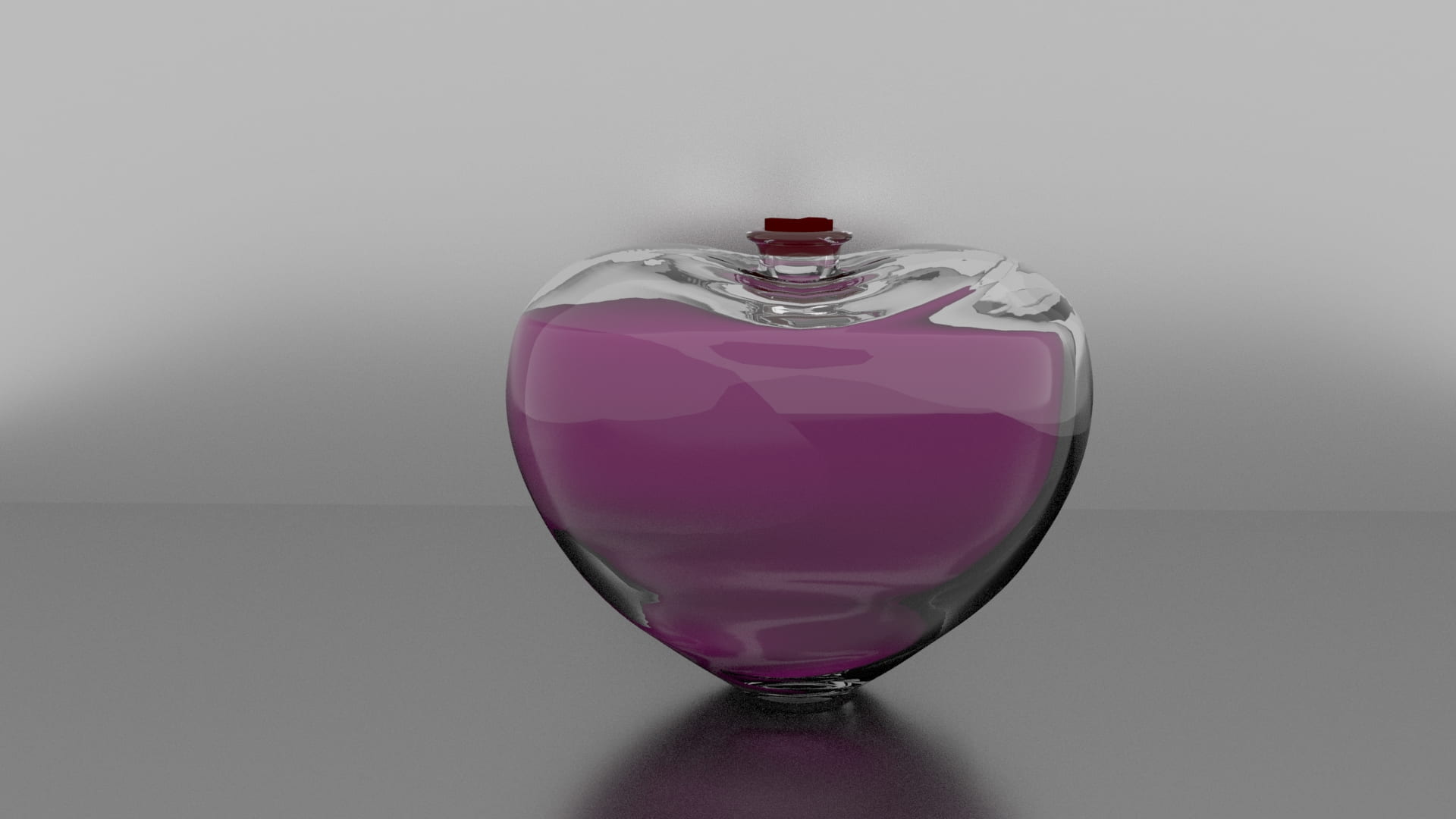 Heart shaped bottle of a pink liquid.