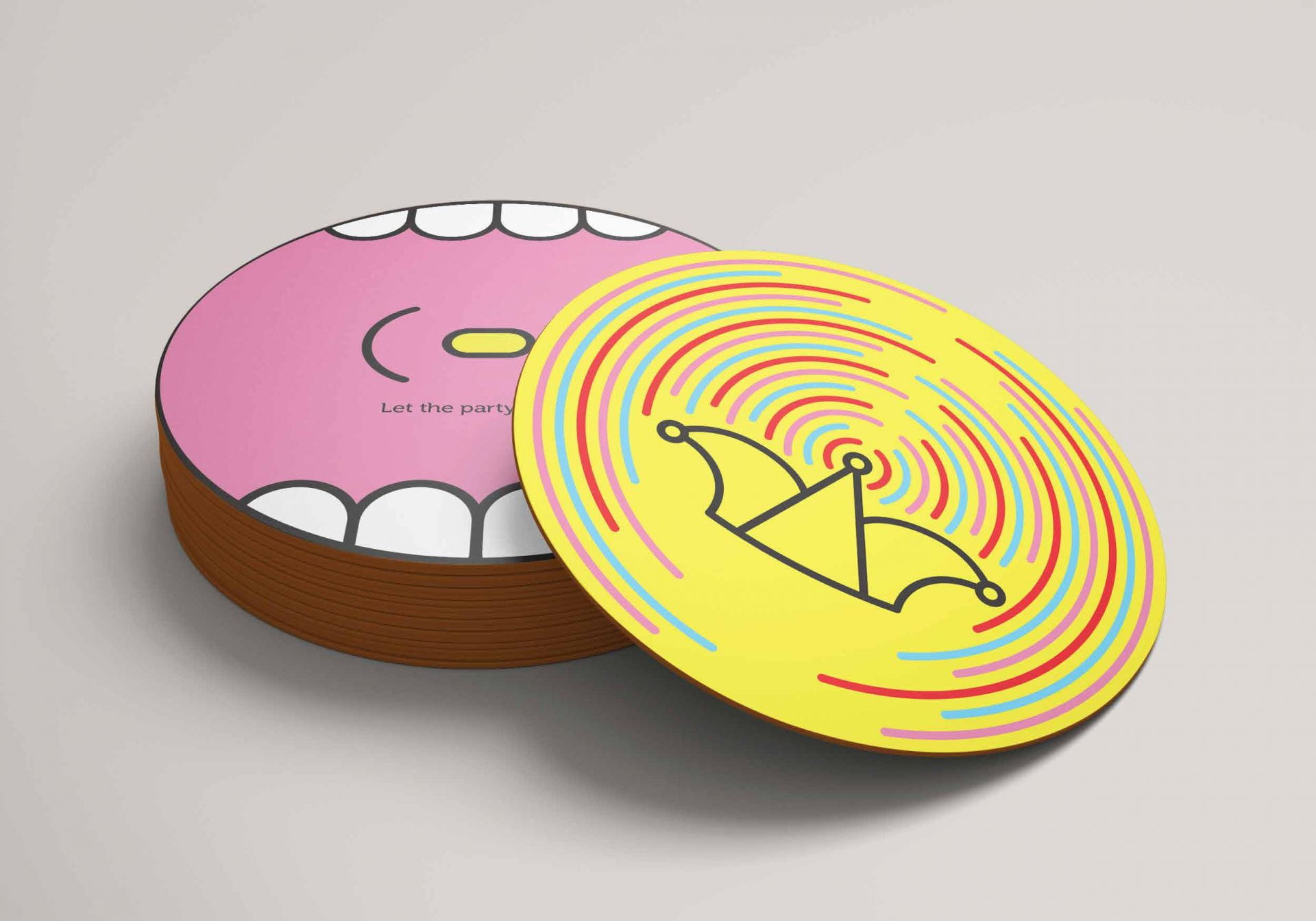 A pink coaster, an illustration of an open mouth with a pill inside, text reads: