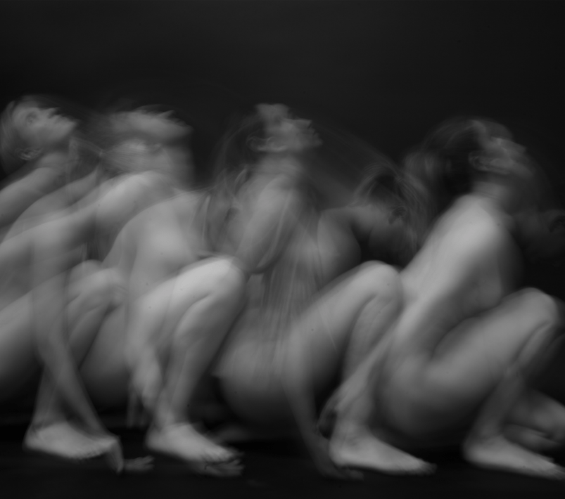 Blurred black at white photography of nude women.