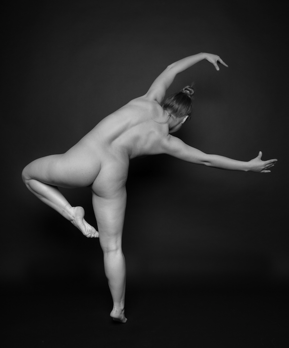 Black at white photography of nude woman in ballet pose.