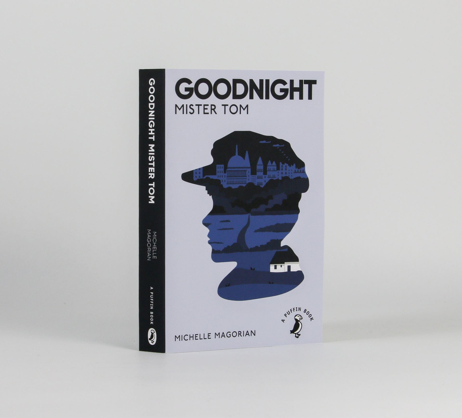Book cover reading 'Goodnight mister tom' with a silhouette of a boys head with the city inside