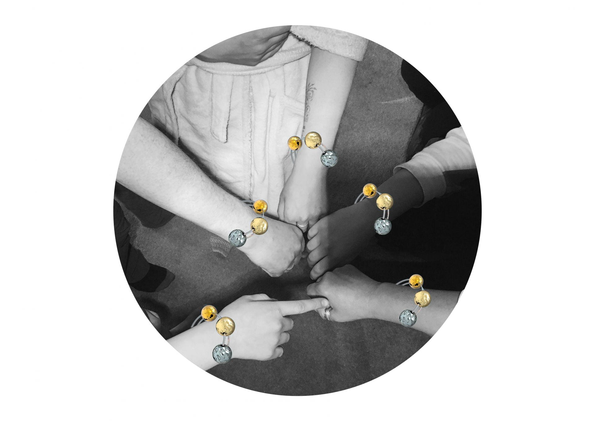 A black & white image of people's hands extended into the centre, with large coloured beads on each of their wrists.
