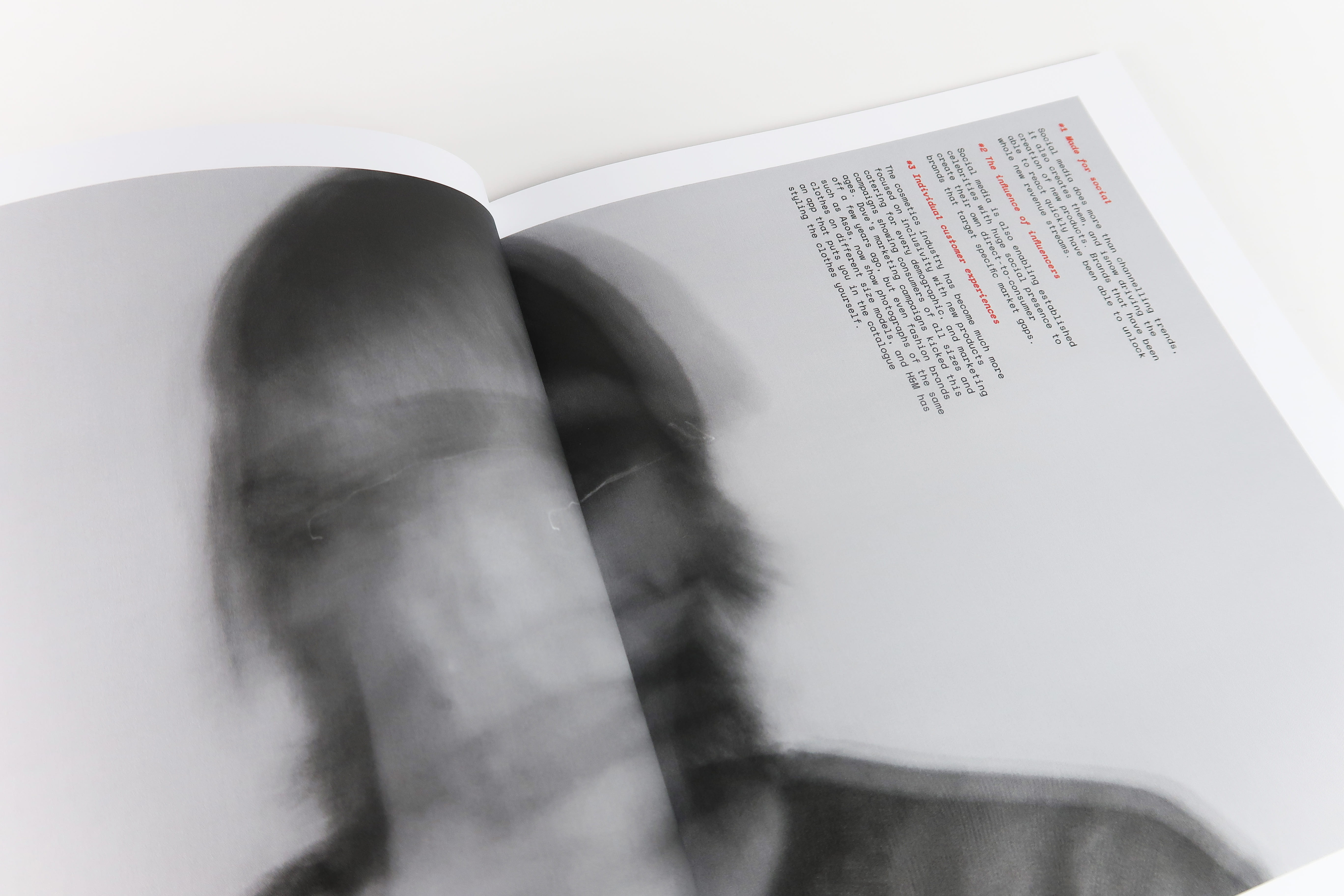 A double page magazine spread, a male shaking his head, the face is blurred and no features are visible.