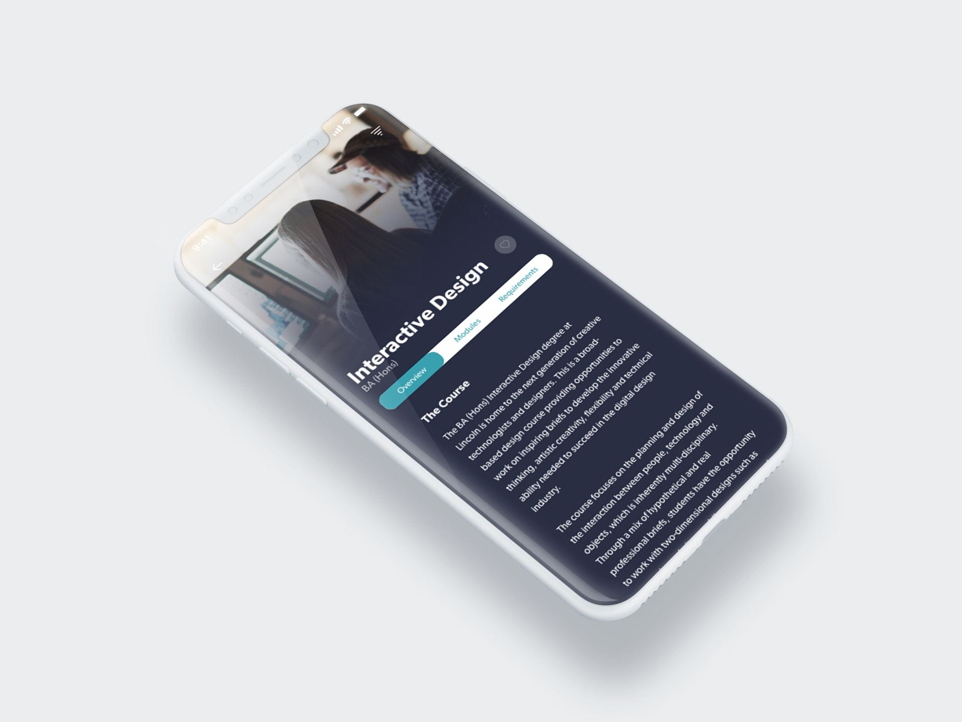 A close up of an iPhone X, displaying a page with text that reads: