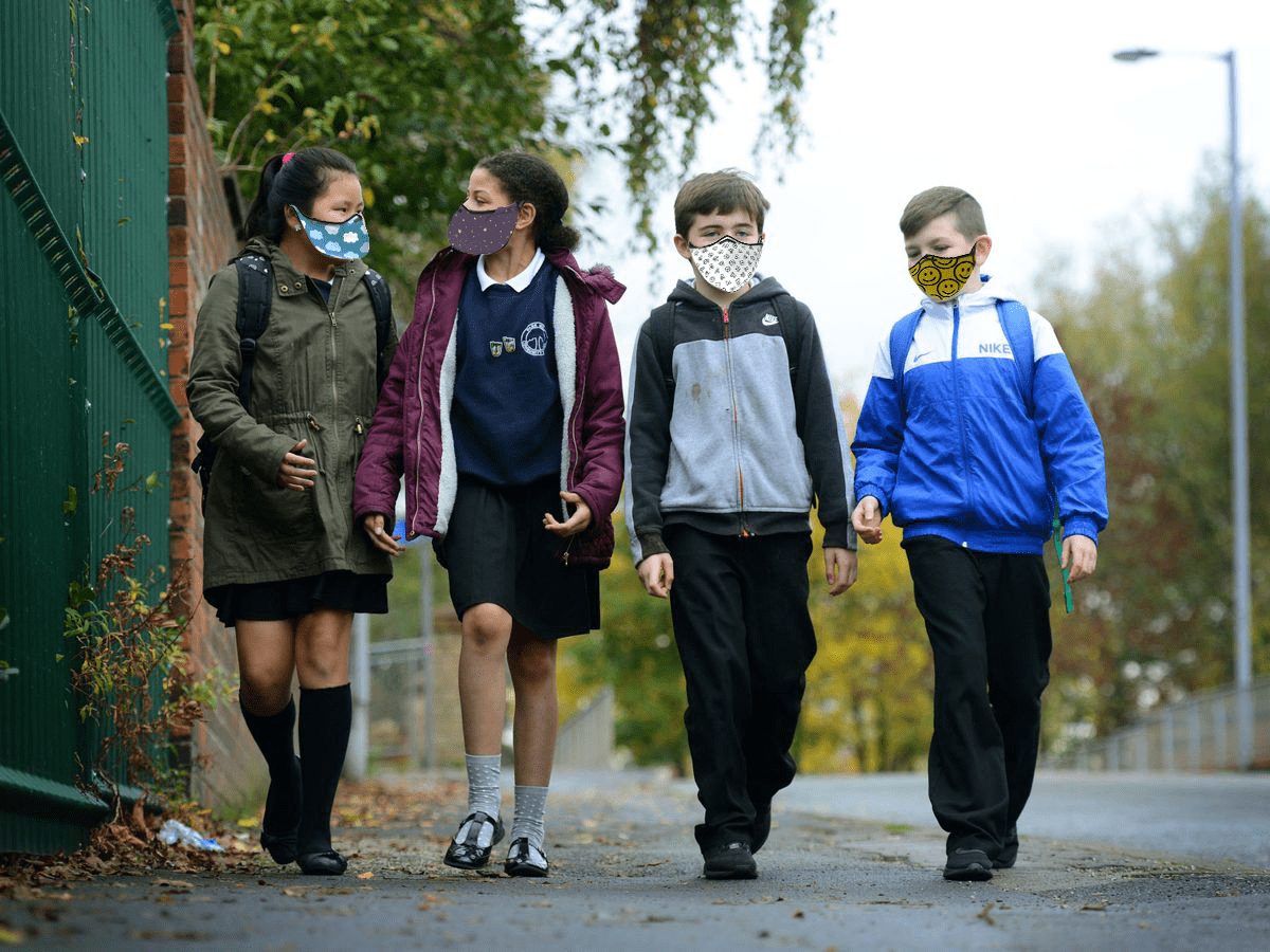 Children wearing face-masks.