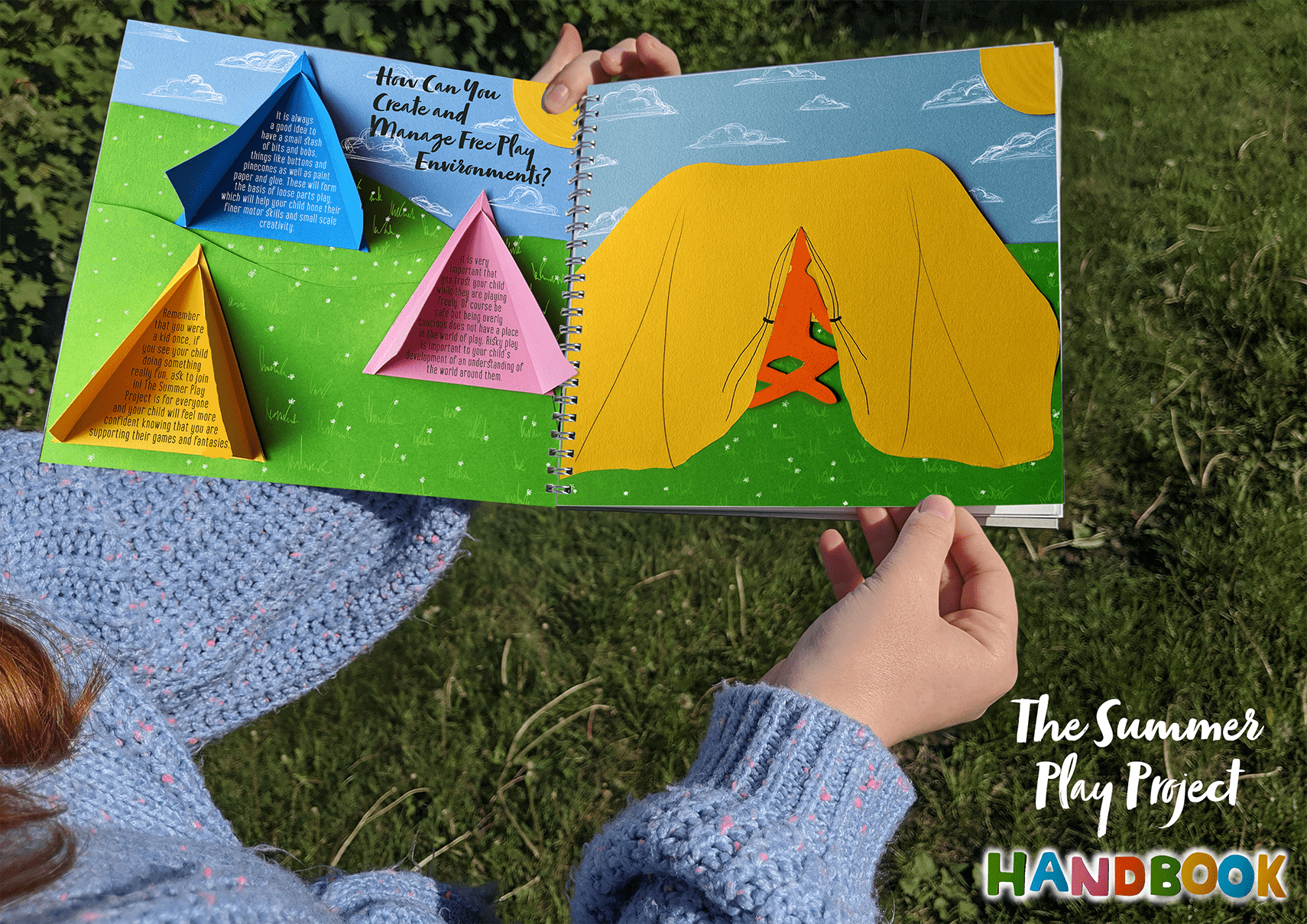 Someone holding a brightly coloured book - the first section of The Handbook contains information on free play, laid out like a children's lift-the-flap book.