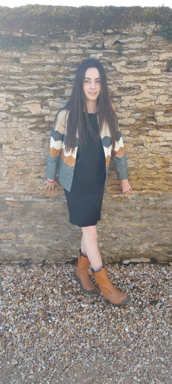 Model wearing a leather jacket.