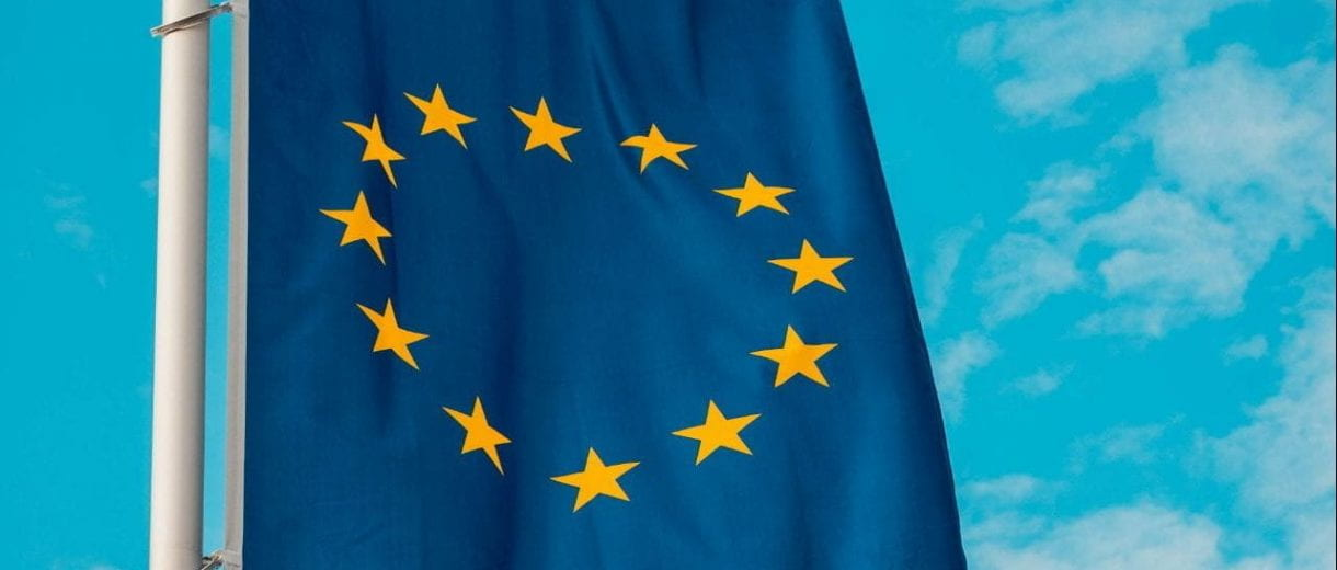 Student Services - Flag of Europe against a blue sky.