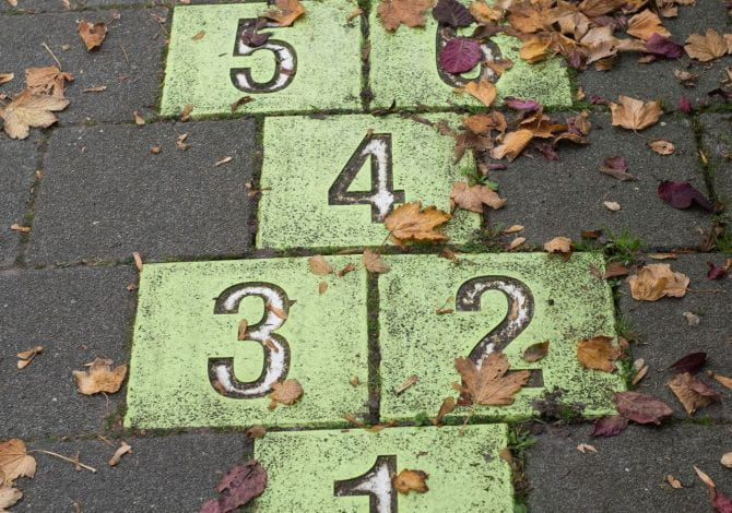 Student Services - Hop scotch track on pavement.