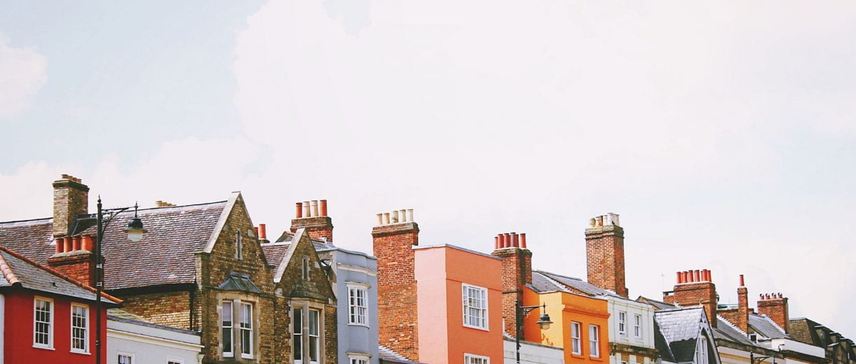Student Services - A row of brightly coloured buildings.